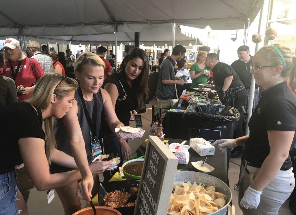 Fans sample food at last year's Cheribundi Boca Raton Bowl's Tailgate Party. COURTESY PHOTO